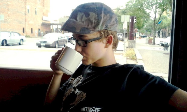 Title: A Boy and His Coffee. Photo: Christina Sanders-Ring, 2014-08-23. Used with permission.